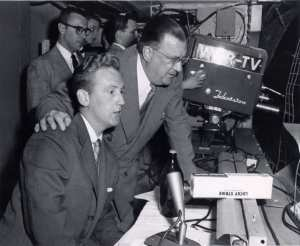 Vin Scully and Walter O'Malley during a Brooklyn Dodger's broadcast