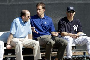 Will Kunz is seen seated between GM Brian Cashman and Manager Joe Girardi (Photo courtesy ESPN)